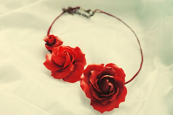 Realistic red roses, hand sculpted from polymer clay and assembled into a wonderful necklace.  Each detail is important when it comes to your special day, so make sure you choose the right accessories. innette.etsy.com
