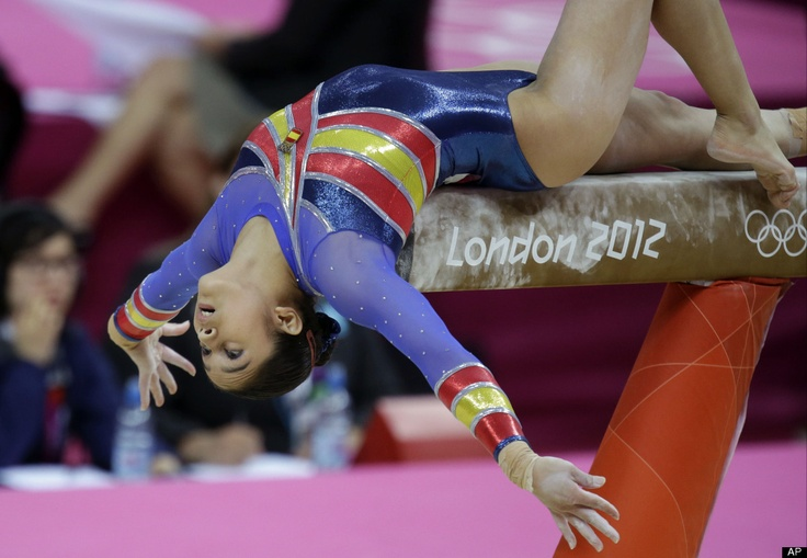 Spanish gymnast Ana Maria Izurieta performs on the balance beam during the Artistic Gymnastic women's qualifications at the 2012 Summer Olympics, Sunday, July 29, 2012, in London.