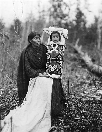 Ojibwa mother and child – 1913   Looks like Cathy and Michele's jaw and cheekbones