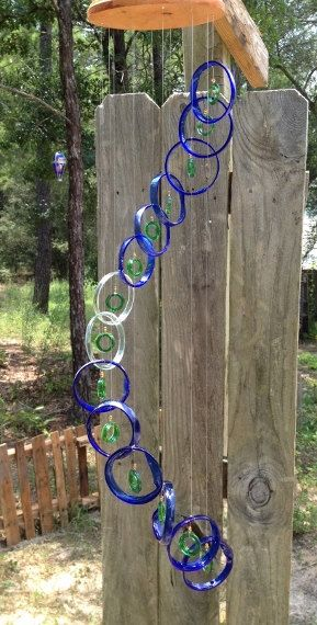 I LOVE THE SOFT FEEL OF THIS WINDCHIME. COBALT BLUE RINGS SEPARATED WITH SEAFOAM RINGS GREEN BEER NECK CENTERS AND YELLOW GLASS BEADS  A LOVELY