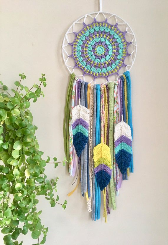 Universe  -Concept and Description- Thank you for coming to see my work, the concept is... Tibetan Mandala x Chakra Color x Native American Dream catcher. Mandala part is crochet by me. Inspiring colors are Blue, Purple and Yellow Green.  I made this by imagining the Universe, great