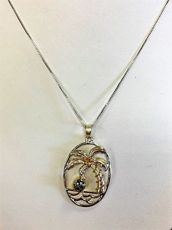 Sterling Silver and 22K Gold Vermeil Palm Tree Pendant with Bezel Set Sky Blue Topaz. #beachwear #palmtrees #necklaces #christmasgifts #giftsforher