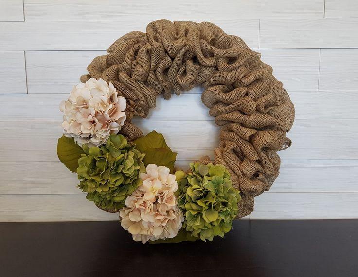 Burlap Wreath with Spring Flowers . . #goldenforrest #goldenforrestcreations #burlap #burlapwreath #handmade #wreathideas #frontdoordecor #flowerwreath #flowers #spring