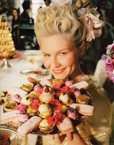 Kirsten Dunst as Marie Antoinette holding Petit Fours from Ladurée for Marie Antoinette film {2006}