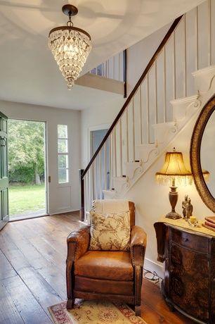Entryway with Standard height, Hardwood floors, six panel door, Chandelier