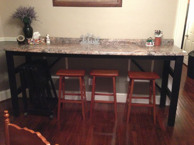 bar for eating and extra kitchen counter space buffet for