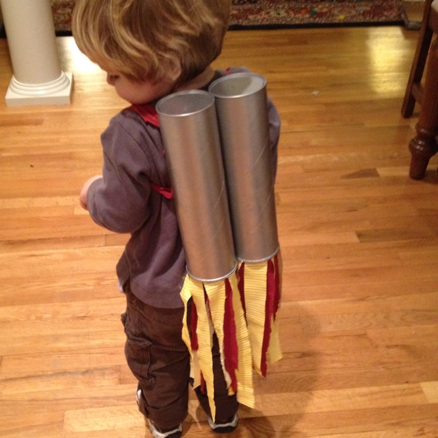 Oliver's rocket pack. Pringles cans and fabric strips.