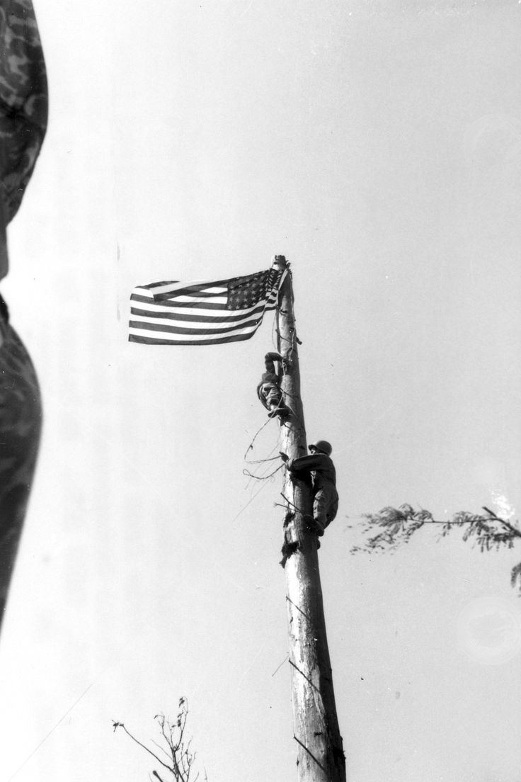 503rd Parachute Infantry Regiment, 11th Airborne Division as they raised the American flag over Corregidor Island during the airborne operation there in early 1945.
