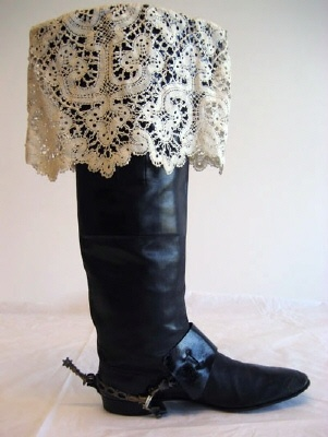 Boot with lace and sporrläder.  NAME  Manufacturer :T Trane  Owner :Oscar II of Sweden (-Norway)  Donors :Gustav V of Sweden  COLLECTION OF THE  Royal Armoury  INVENTORY NUMBER  27340 (51:151: f: 2)