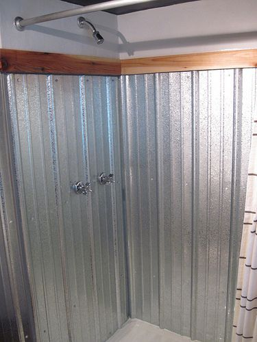 I really like these galvanized showers... clean with vinegar and water and use rustoleum
