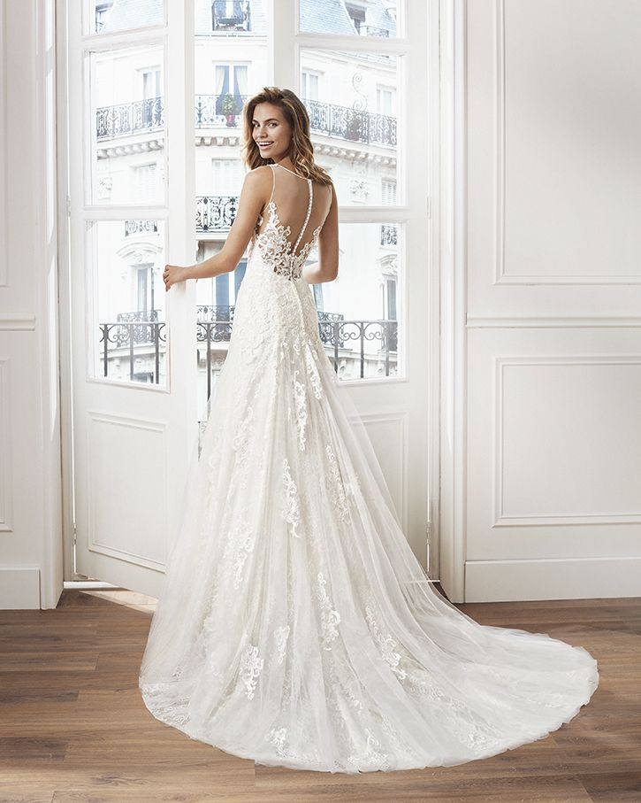 sheath-style wedding dress in lace. v-neckline and appliqued skirt