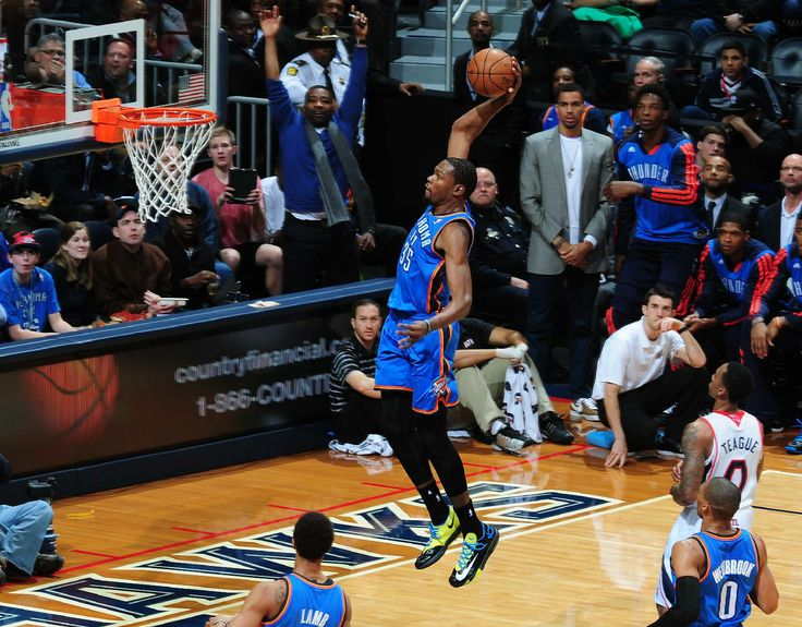 ATLANTA, GA - DECEMBER 10: Kevin Durant #35 of the Oklahoma City Thunder goes in for the dunk against the Atlanta Hawks on December 10, 2013 at Philips Arena in Atlanta, Georgia. (Photo by Scott Cunningham/NBAE via Getty Images)