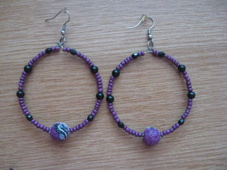 my mother made those two ones in the middle using polymer clay. rest are normal black and purple beads