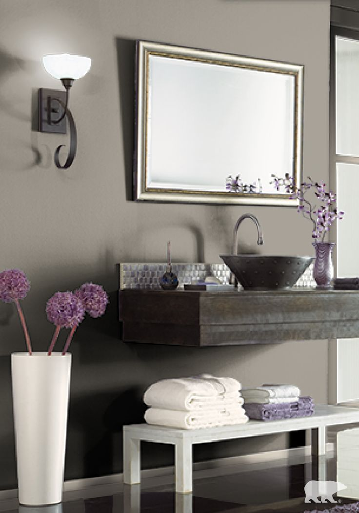 Stay on trend this season by coating the walls of your bathroom with BEHR paint in Fifth Olive-nue. When combined with accents of rich purple, this hue will make your space feel not only modern and fresh but relaxing as well!
