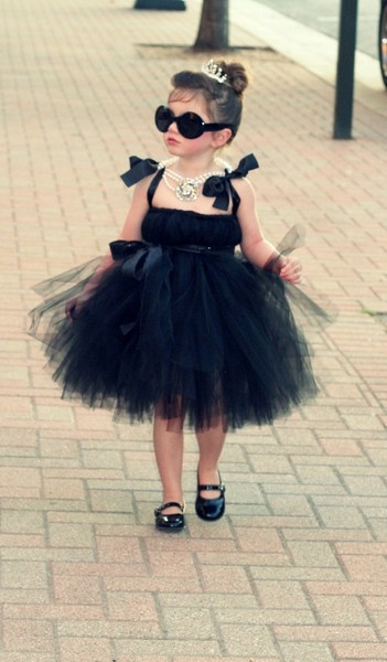 little girl :) reminded me of Audrey Hepburn I think Calista should dress up her this year!!!