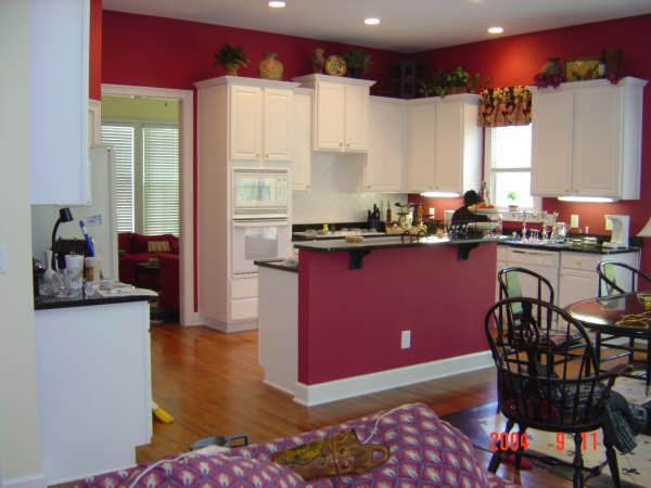 may change the kitchen to red and get rid of the red in the living room - Kitchen Paint Ideas White Cabinets