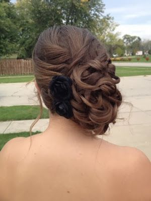 A curled side swept updo with an accent braid. #hairbykimberlyboshold