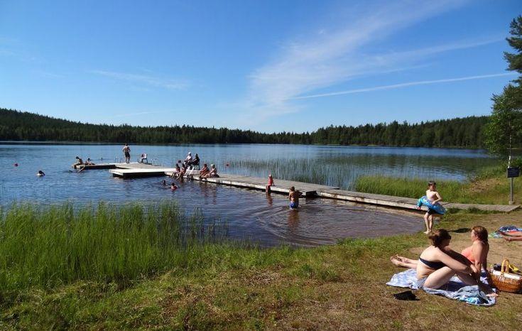 Valkeajärvi Lake swimming beach in Ritavaara holiday center in Pello, in Lapland