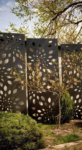 Garden Sculptures...so much better than a typical fence.