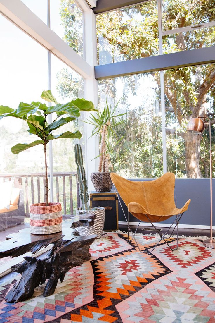 Plants thrive in the bright light of Capri's living room, offering a little extra bohemian touch.  #refinery29 http://www.refinery29.com/riawna-capri-home-tour#slide-5