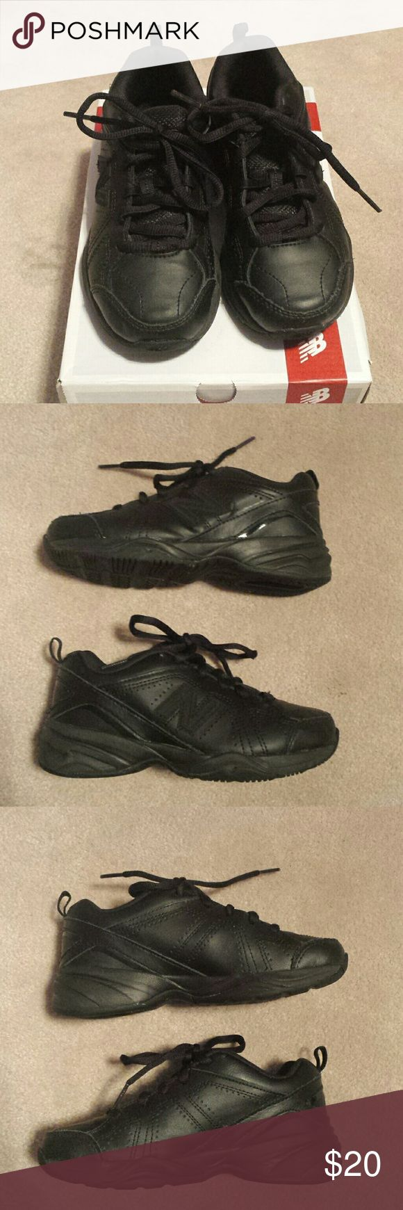 New Balance Training Black Sneakers New Balance Training Black Sneakers.  Perfect for school uniforms.  Excellent condition.  Minor discoloration on bottom from lite wearing. 17 on tag for identification. Comes with original box.  Smoke free house. Reasonable offers are accepted and I discount bundles. Let me know if you have any questions. New Balance Shoes Sneakers