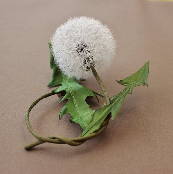 A garden weed? Or another amazing nature creation? This silk dandelion clock has been meticulously created from pure silk to become a most unusual textile dandelion art brooch. The dandelion clock looks so real you catch yourself blowing on it. This dandelion clock can become a whimsical grooms boutonniere at a dandelion themed wedding. The silk dandelion clock brooch has been featured in issue 124 of Textile Fibre Forum magazine. ❀ original flower piece by PresentPerfect Creations Studio…