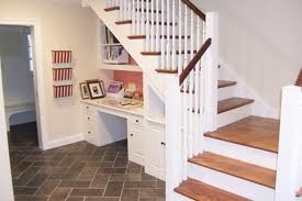 desk under basement stairs, make sure there is room for two monitors.  Put printer in filing cabinet drawer.
