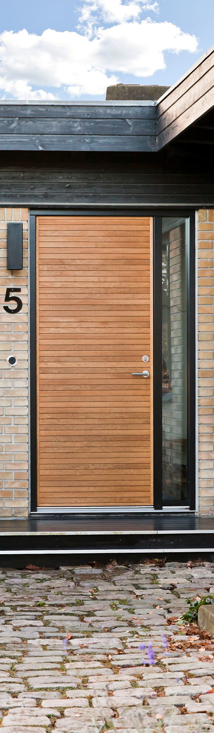 Architectural exterior door model Aros in light oak from JE-Trae - produced by Vahle Door in Denmark.