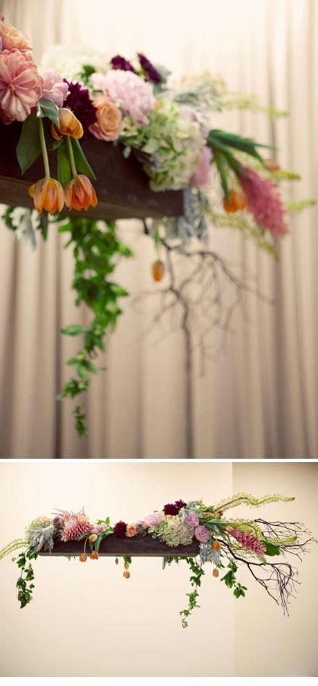 Hanging flower troughs suspended above the tables from the beams? then just candles on tables???