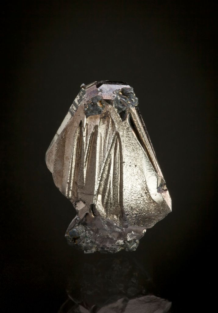A significant specimen of a very rare copper bismuth sulfide: this is a sharp thumbnail crystal which was collected over 30 years ago from this now-defunct copper and bismuth mine.