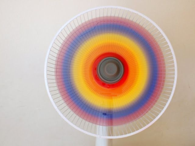 Paint a fan's blades different combinations of red, yellow, and blue. Then, turn it on to reveal a lovely rainbow!