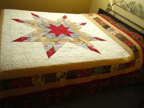Josh & Shelby's wedding quilt, Double Chocolate Star, custom quilted