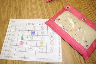 """Love this idea!! Mrs. Ricca's Kindergarten: Literacy Centers **""""I Spy"""" Bags - I made these using pencil pouches, rice, and poly-beads. The children hunt for letters and record their findings by coloring in the letters on the recording sheet."""