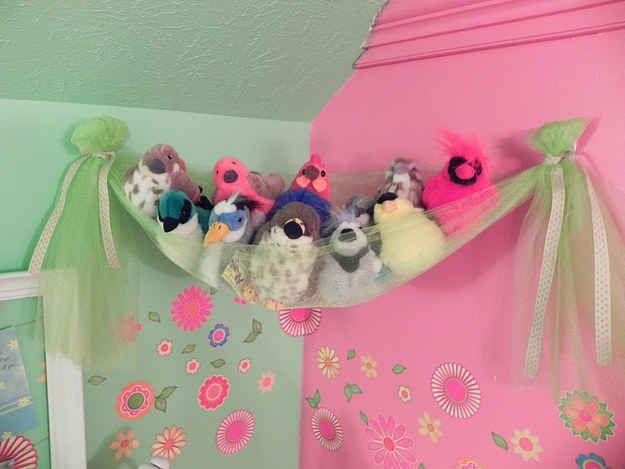 Hang a swath of tulle from Command hooks to create a stuffed animal perch.