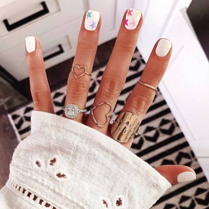 White nails scream holiday vibes, update them with some colourful stars like Stella And Shay and you're onto a winner.