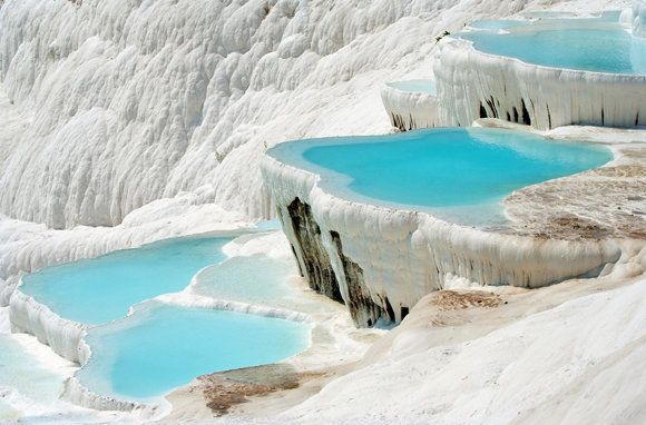 Pamukkale, Turkey   These natural pools and terraces are formed by calcite deposits, said to contain healing minerals of therapeutic qualities.