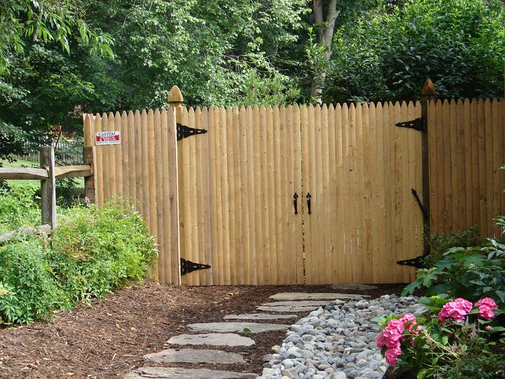 6 foot wood privacy fence, stockade style, with double gates