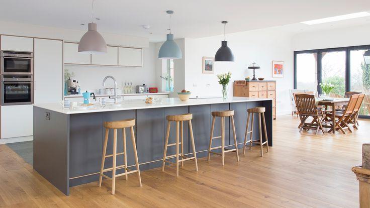 Modern white kitchen with blue island