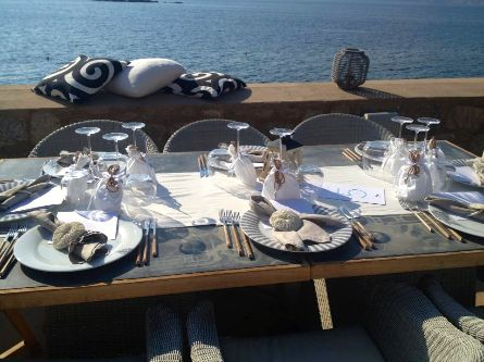Castello - Magic on the Beach at Kamini in Hydra Island magically blends a glamorous beach bar, sophisticated restaurant for lunch or dinner and will make sure your wedding reception is everything you dream of.