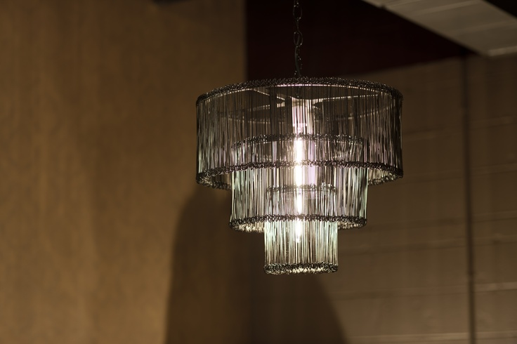 ERICA ISLAS TOP PICK  Splurge by Robert Nicholas showing at the Antique & Design Center at Market Square, MSG-ADC 6-6a. Hundreds of individually wrapped wires give the light the ability to illuminate a room by creating vertical shadows on this 3-Tier Chandelier  On twitter: @splurgedesign