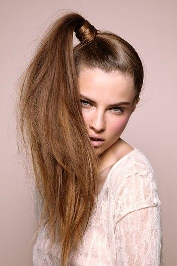 high ponytail to the side. I feel Ike if I were to model, I would get stuck with this hairdo!!! Def. something that would happen to me, so I feel sorry for this lady