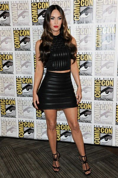 Megan Fox in a leather two piece, crop top and skirt