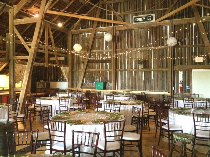 Love barn weddings. Gorgeous ivory linens for the perfect rustic wedding with our mahogany chiavari chairs. #rustic #weddings #affairstoremember #chiavarichairs #ivory #linen