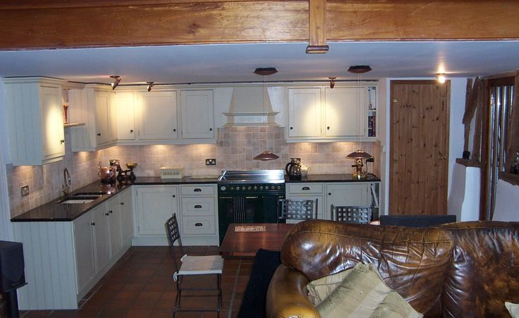 A pair of copper pendants co-ordinate with the wood in this listed barn conversion.