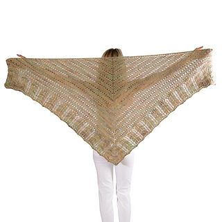 SKEINO's PRETTY SHAWL is a wonderful triangular shawl. It is knitted from the neck down in a lacy pattern with a Chevron Border.