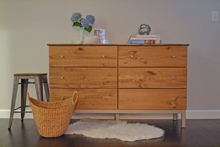 HOME D.I.Y.-- Take a wood IKEA dresser, and stain it, give it some new knobs and voila! You've got a fancy new dresser!