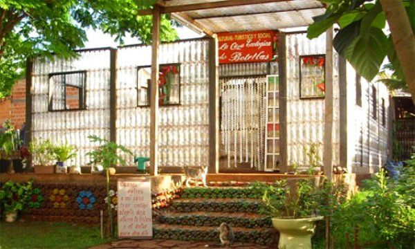 A multitude of pictures at this site, showing homes, greenhouses, and other functional structures made from plastic bottles and other found materials.