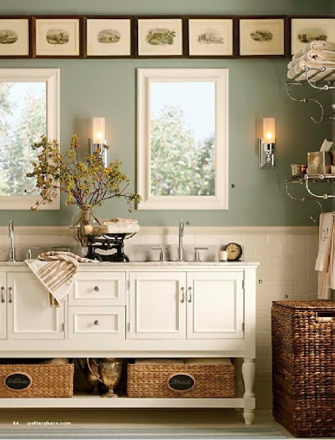 Love the colors - Green sea glass wall with soft white painted furniture. Natural cane and wicker materials for baskets and hamper