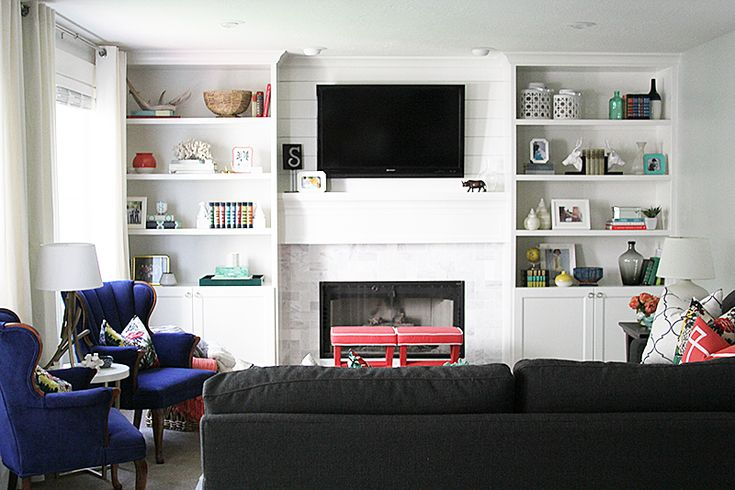 love this family room-- layout looks almost identical to mine.  I'd love to add built in bookcases and retile the fireplace just like this