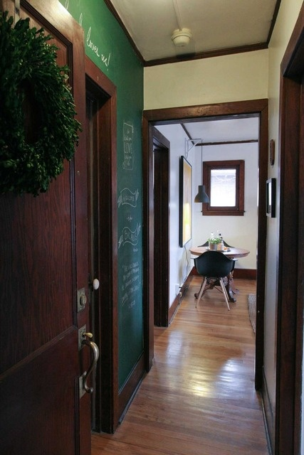 entry (love the green chalkboard paint)- Bacalis Apartment Tour (via AT)